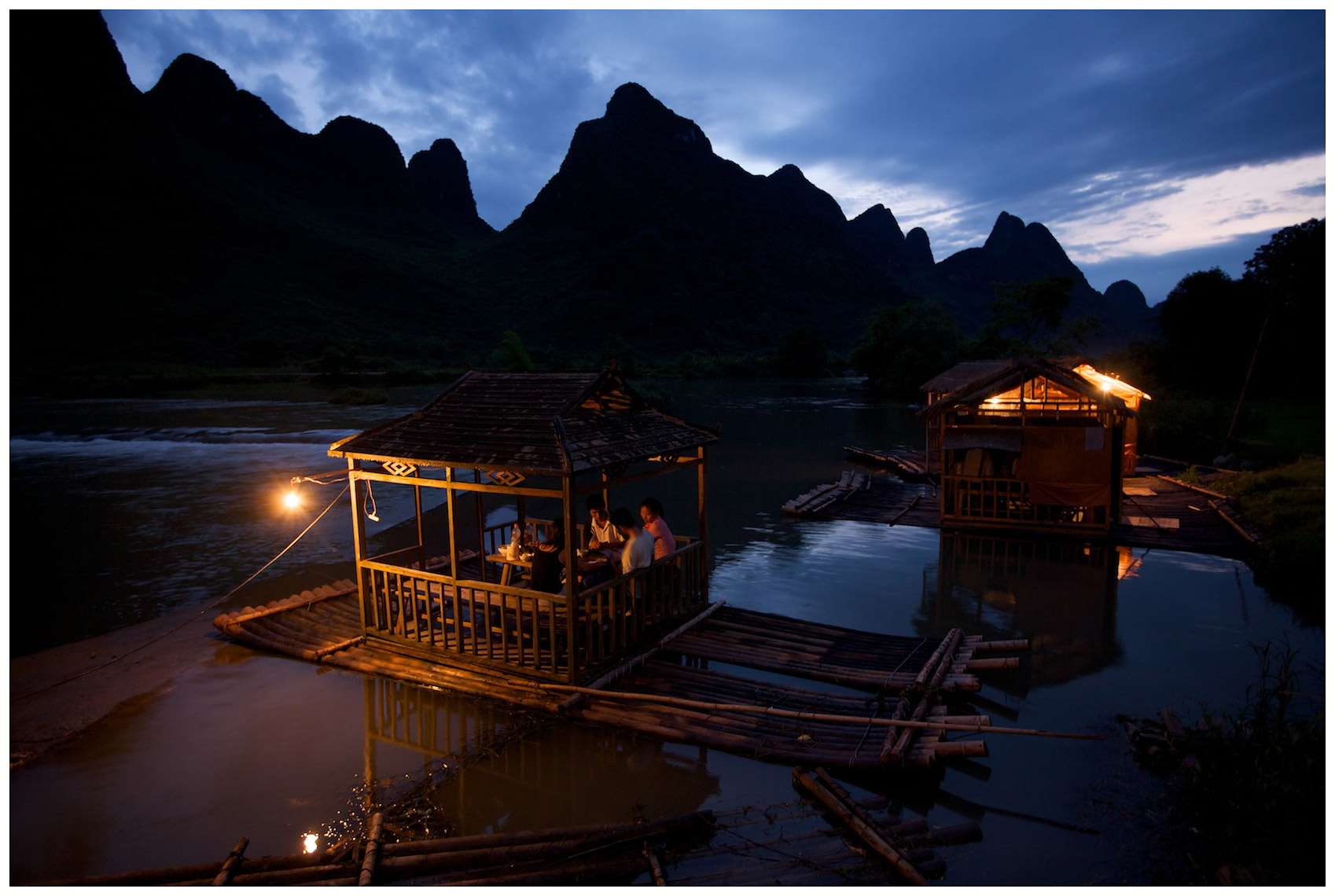 Floating restaurant tables on a subsidiary of the Li River