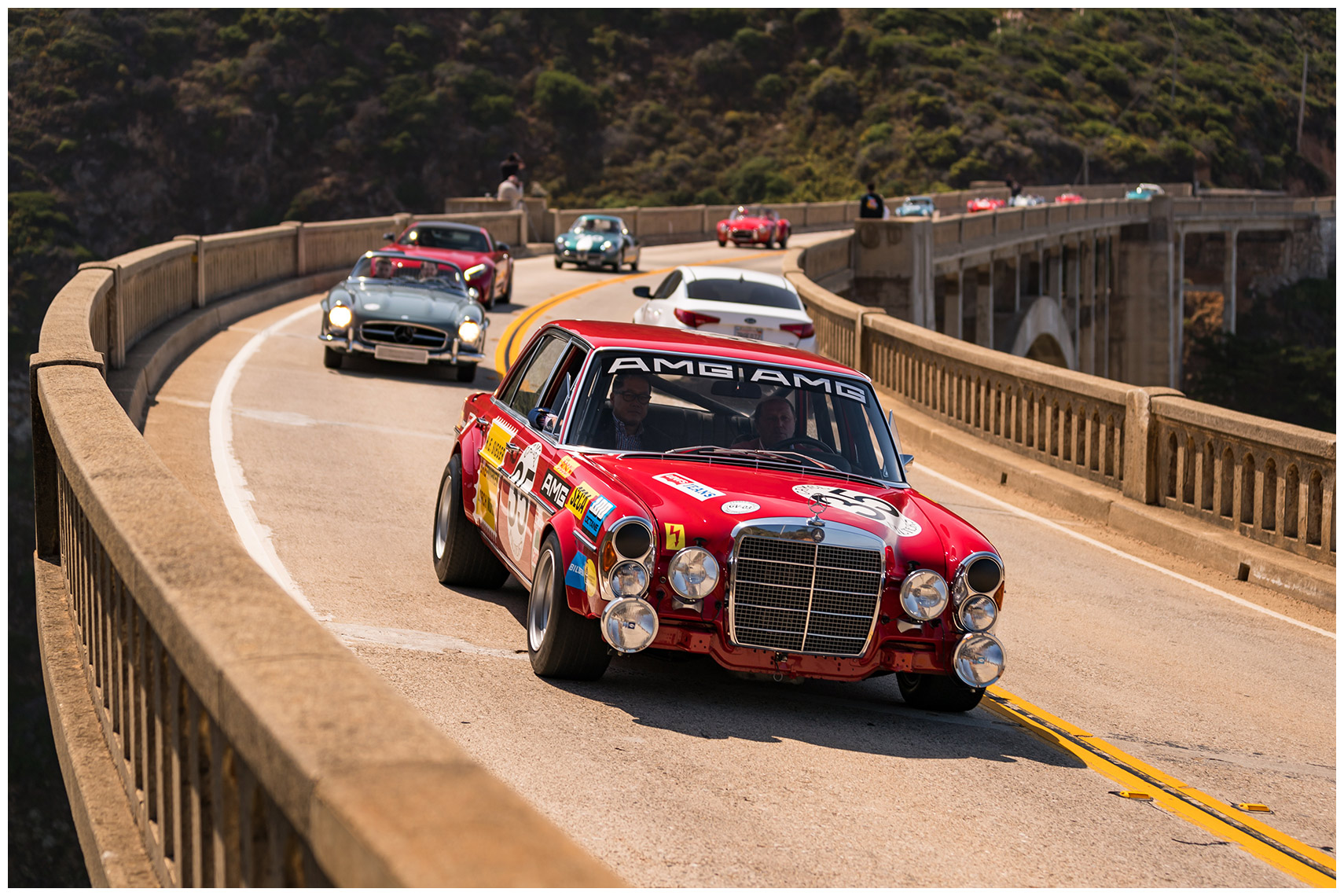 jochen mass drives the amg 300 sel 6.8 red pig across the bixby bridge in the 2017 tour d
