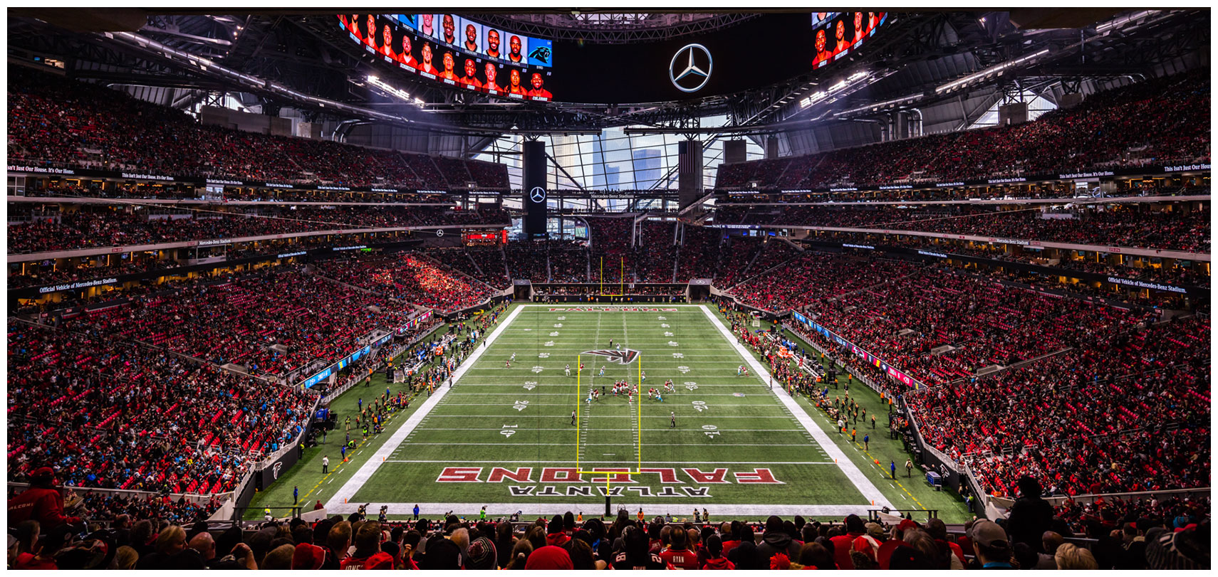 panoramic mercedes-benz stadium during a falcons game glass skyline