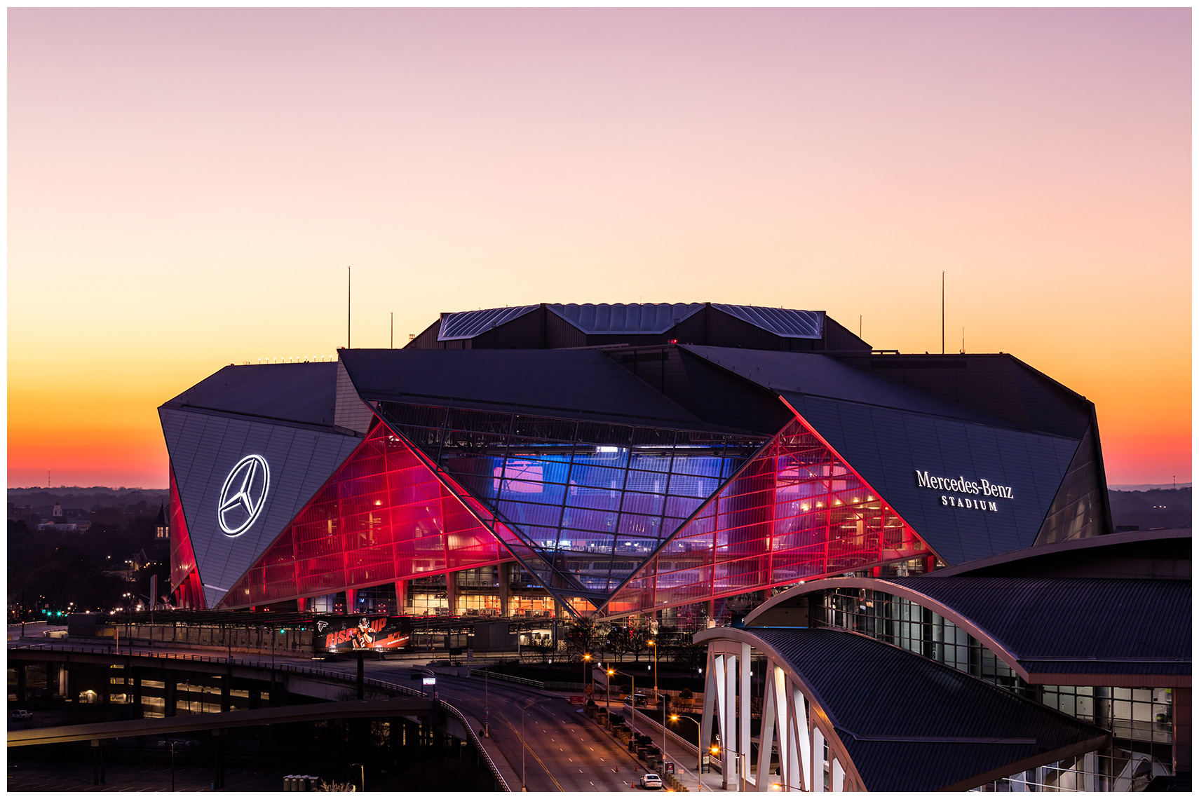Exterior architecture of the Mercedes-Benz Stadium just after sunset.